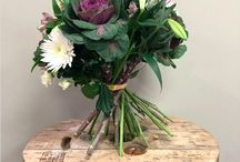 Hand Tied Bouquets / Hand tied bouquets in a variety of styles and colours. (Rustic hand tied bouquets). Bouquets including roses, ribbons, foliages, in a variety of sizes. Hand tied in water.