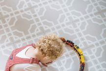 Adorable Kiddos showing off Mirth Studio's colorful and patterned Hardwood Floors