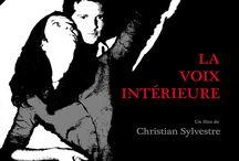 La Voix Intérieure / Il s'agit d'un drame en huis clos avec Marion Jadot et Arthur Keller dont le thème central est la schizophrénie. Pitch : une jeune femme introvertie est confrontée à la jalousie maladive de son petit ami.