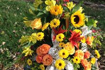 Fall Flower Arrangements / The bright bold colors of fall, using pods, wheat, cat tails, and pine cone in rustic containers