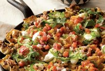 "Loaded Nachos / ""Loaded"" doesn't have to mean loaded with calories. The combination of black beans, salsa, and nonfat Greek yogurt makes this version of nachos a multicultural feast without the fat. Be sure to buy ground turkey made just from turkey breast - not regular ground turkey, which is made from white and dark meat and skin. The fat and caloric content of the two is significantly different. / by Rocco DiSpirito"