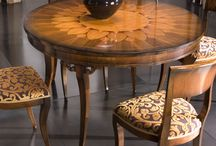 Tosato's sunflower / Sunflower table from our Favoriti collection, a creation with a walnut veneer and inlays, in valued wood such as chestnut, maple, cherry and boxwood.