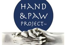 Hand and Paw Project™ / These gorgeous, unisex bracelets show a human hand holding a dog's paw. These bracelets simply and powerfully depict the close and special relationships that humans have with their animals. Everyone who wears this bracelets helps animals in need.