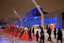 Luminothérapie 2012-2013 / Luminothérapie consiste en un événement hivernal issu d'un concours à deux volets ayant pour but la mise en  valeur et l'animation de la place des Festivals, et la conception et la réalisation de contenus de vidéoprojection sur  huit façades du Quartier. Ce concours est géré en collaboration avec le Bureau du design de la Ville de Montréal. Durant l'événement Luminothérapie, l'espace public se transforme en un musée à ciel ouvert qui illumine l'hiver et célèbre le génie créatif montréalais.