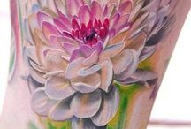 Watercolor Flower tattoo. Amazing color and effect.