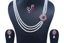 3 Lines Rich Pearl Necklace Set in Semi Precious Ruby Pendant at Rs.8600