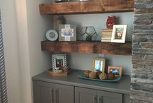 built in cabinet with oak floating shelves