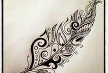 Tatuajes de pluma blanca