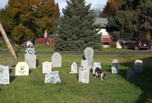 """2013 Halloween Cemetery & Deck / My haphazard cemetery. I decided at about lunch time (on Halloween day) to decorate the yard. The rain had stopped for a couple of hours so I made a dash for it and threw some stuff into the yard. I had started to decorate the deck  couple days before Halloween. The tombstones are made of recycled styroboard left over from my house reno and the props are made of paper mache. I am not creative or artistic so I """"borrowed"""" several ideas from HalloweenForum.com members and other Pinterest boards."""