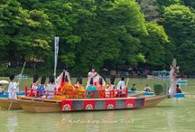 Imperial Boating Party in Arashiyama: Mifune Matsuri. / The annual Mifune Matsuri was held in Arashiyama, Kyoto. This festival has commenced for the past 1.000 years along the  Ōi River. After a brief ceremony at the nearby Kurumazaki Shrine (車折神社) the participants, all dressed in the old Heian style garb, crossed the Togetsukyō bridge (Moon Crossing Bridge-渡月橋) towards the shore of the Ōi River (大堰川). There where loads of people watching this event and it is said that more than 100.000 people come to view this festival.