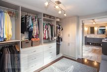 Cool Contemporary Closet - Norwell, MA / This walk-in closet design sits adjacent to a contemporary master bath, connected by a sliding door. The closet space is packed with ample storage, including drawers, open shelving, hanging storage, and closed cabinetry. The white cabinetry contrasts beautifully with the mocha pre-finished plank flooring. Photos by Susan Hagstrom