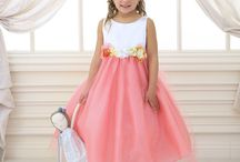Flower Girl Dress with Multi Color Flower Accents / This girls special occasion  will have your little girl looking like the little princess that she is. This beautiful , girls dress is perfect for flower girl, Easter, parties, first communion, or any special occasion . This flower girl dress features a fully lined, tea length tulle skirt, plain satin bodice with multi color flowers along waist. The back features a zipper closure with tie bow.