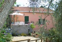 """I 99 Olivi_Bianca / """"Bianca"""" is about 65 square meters (700 square feet) and is located on the first floor of the """"Casale di sotto"""". It consists of: a kitchen, a bathroom, two bedrooms (one with a double bed and one with two single beds), a dining room and a small living room with a balcony offering an impressive view of the bay of Imperia. A cot will be provided on request. The guests may also enjoy the benefit of a lovely patio and of a small garden with a barbecue."""