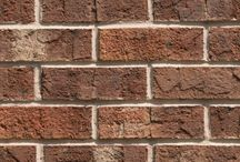 Georgian   Triangle Brick Company / Both your brickwork and the intricate architectural accents of your building will be showcased by the luxurious variety of tones in the Georgian brick. Swatches of color ranging from dark brown to cream add variety and dimension to this copper-colored, sand-faced brick in Triangle Brick Company's Standard product tier. The Georgian Brick is sure to give your building an ornate look that's ready to be embellished with extravagant features.