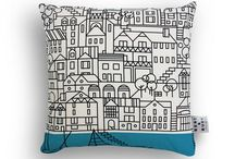 CUSHIONS / Sofa, bed or chair... cushions are an easy way to add colour, pattern and texture to your home. That's why we've created the stylish Bert & Buoy coastal cushion collection. Choose from a variety of unique designs, all illustrated by Bert and applied onto natural cotton with a luxe feather filling. Go matchy-matchy or mix them up for clashing coastal style.