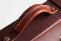 manija de portafolio o maletín