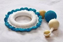 Baby Teethers / This toys helps to develop fine motor skills of your baby: It has different texture (wood, crocheted cotton), different shapes and different colors.  from http://www.etsy.com/ru/shop/YarnyWishes?ref=si_shop