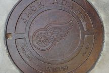 """Red Wing manhole covers LCA Detroit / Some of the greatest Red Wings and Pistons players over the years are immortalized as manhole covers inside the Little Caesars Arena concourse. Has a nice, gritty """"Hollywood Walk of Fame"""" style to it.  Sergei Fedorov may not have his No. 91 retired (yet), but at least he's got one of these."""