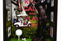Quadro Keep Calm and Play Golf / Quadro Golf Tamanho 29 cm L x 14 cm P x 35 cm H. Elaborado em mdf e acabamento com cera de Embúia. Criação e desenvolvimento digital dos quadros, papel de parede adesivo, uso de madeira balsa, bola e stckers de golf, grama de ferromodelismo, estatua em resina, apontador em lata e carrinho plástico.