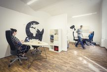 Design Offices / We designed our new offices based in Prague. Tabletops are made as airplane wings, drawings on the walls are from artist, friend of ours and the whole space is done so that we can come up with creative ideas for our clients.