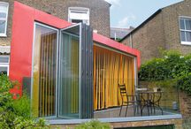 West London Extension / A tired glass conservatory has been replaced with a dynamic new diagonal form which sweeps across the garden of a mid-terraced house in Ladbroke Grove, West London. A natural copper cladding is used to provide a modern vibrant solution to extend the property. The copper cladding will over time oxidise and change from orange to green overtime in the same manner as the roofs of the traditional architecture of London.