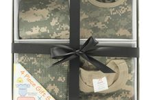 Camo Baby Clothes / Our camo baby gift sets are fantastic all in one, ready to go, cool baby shower gifts. We have ready made sets or you can pick and choose any of the products in the camo section to make up a set. Our most popular sets include 3-6 month camo one piece baby body suit, a matching beanie, bib, and blanket all in one gift box with a bow! Add a rock lullaby cd or a pacifier to your order and you will have the best gift at the shower guaranteed!