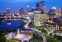 Scioto Mile / Located in the heart of downtown Columbus, the Scioto Mile is an urban oasis comprised of more than 145 acres of lush parkland. Stretching along the riverfront from the vibrant Arena District to the natural beauty of the Whittier Peninsula, the Scioto Mile reconnects downtown to the Scioto River through an integrated system of parks, boulevards, bikeways and pedestrian paths.