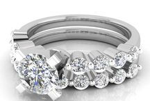 Bridal Rings Sets / If you are looking for a diamond wedding set for the love of your life, these sets will melt your heart. Each diamond wedding ring set we have comes with an engagement ring with a gorgeous centerpiece and a wedding band with sparkly diamonds handset in them. Each set has a unique touch that creates a newfound love for them. If you are looking to start a new journey filled with precious memories, one of these sets will steal your heart and capture the lovely moments of this new journey.