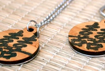 Melissa Lew /  A 1st generation Chinese American, Melissa Lew's designs are heavily influenced by her Chinese heritage, especially the culture's deep respect and esteem for nature. She uses various metals, including precious metal clays, to create unique sculptural jewelry to wear and/or display all works however are primarily made with recycled fine silver and bamboo. She describes her jewelry style as green, eco-friendly, sustainable, and organic.