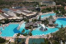 Pegasos World / If you want to experience an incredible hotel for the entire family there's just one choice: Pegasos World. It has the Mediterranean's one of the biggest pool, loads of water slides, a pirate ship, a large sandy beach and its own mall, making it an extraordinary hotel.