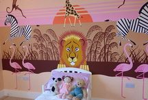 "Safari Lion Mural / This very graphic and stylish Safari Mural was painted for an amazing and articulate little 3 year old girl. The design was based on some animal images that the ""mum"" had seen which I then created and painted this almost symmetrical design to fill the feature wall. The pale terracotta signature colour from the main walls was also featured into the mural."