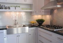 The Tile Shop: kitchen with white cabinets and stainless steel accents