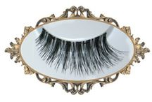 Glam Lashes / Various styles of faux lashes to fit your every need. Some are even hand-embellished with rhinestones for that very special occasion. All sets come in a re-usable plastic case and include a tube of glue for your convenience.