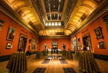 Central Hall / This spectacular room, beautifully lit by an elevated glass rooftop, showcases Northern Italian paintings from the 16th-century. The striking marble entrance way leads up to an intricately decorated ceiling of golden leaves,making it a truly regal setting. Located just off the Portico entrance, Central Hall is perfectly situated to accommodate exceptional receptions and dinners. Reception capacity: 200 | Dinner & Breakfast capacity: 100