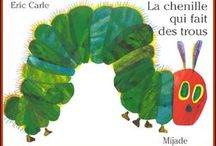 La chenille qui fait des trous / by Julie Moreau