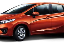 Honda Jazz / The Honda Jazz stands apart with its sporty crossfade monoform design. Bold, super-slick front strongly expresses attitude whereas side character lines, dynamic alloy wheels and rear spoiler makes heads trun every time. It's an aerodynamic burst of energy symbolizing speed and control.