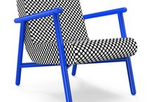 Fillet Chair / Elegance, timelessness and exceptional sitting comfort are the unique properties of FILLET armchair. Available in various bold colors and high quality upholstery fabric, this design is an ideal piece of furniture for a perfect living.