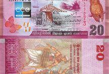 Billets Sri Lanka / La roupie Srilankaise (LKR) est la monnaie du Sri Lanka, divisée en 100 cents. Les billets de banque Sri Lanka  en circulation sont : 20, 50, 100, 500, 1000, 2000 et 5000 roupies. La Série du Patrimoine a vu de nombreuses révisions tout au long de son existence depuis 1991. La révision de 1995 avait une image latente au centre bas de la face revers. La révision de 2001 a ajouté une bande métallique plus large aux billets de 500 et 1 000 roupies.