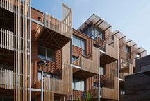 fjellgata / Vertical timber slats provide shade and privacy for staggered balconies