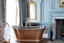 Copper Bulle - Hurlingham / A delightful and enigmatic rounded design personifies this copper bath, highlighted by a large double plinth supporting the bath body. The nickel plated copper has been polished extensively which creates a deep sheen and almost ethereal air to the bath. Also available in full copper, nickel as desired.