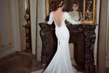 Wedding dresses:contemporary. / Ok...so I didn't go for the all most obvious off the shoulder dresses. I wanted to see some with collars and shaping around the neck décolleté ....and some exclusive unusual dresses. / by Lorna Payne