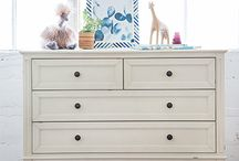 Amelia Double Wide Dresser / With raised molding and recessed drawer panel details, the Amelia Dresser is a perfect companion for the Amelia Crib. Featuring self-closing, ball-bearing drawer glides, it is hand distressed and available in a new weathered cocoa or distressed white finish.