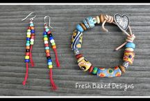 Krobo beads / simple art. lifted up by the hands that formed them.
