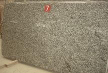 Product Guide- Granite Selections for your Excel Home / Excel Homes offers granite as a counter top choice in our custom modular homes.  This board displays the 14 granite choices available.  Granite- a natural product - can have widely differing pattern/movement/color/grain size so we are showing some pictures of typical slabs of each granite choice.