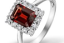 Garnet Engagement Rings / As the birthstone for January, garnet is said to inspire love and loyalty. The red garnet's fiery sparkle and symbolism make it a perfect engagement ring.