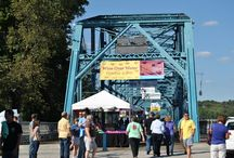 Wine over Water / Wine Over Water is Tennessee's premier wine-tasting festival. You can sample wines from over 100 world wineries, while you stroll the historic Walnut Street Bridge, which spans the scenic Tennessee river. Built in 1890, it's one of the world's longest pedestrian bridges and was the first bridge to link Downtown Chattanooga to the North Shore. It is also the first non-military highway bridge to cross the Tennessee river.