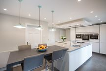 Island Living / A couple who originally requested a traditional kitchen design, are thrilled with their new sleek minimalist living space that has completely changed their outlook.