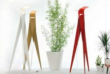 Les Racines collection / Floor lamp composed of three aluminium elements: the colours red, white and flax that present themselves as characterized by a refined texture. Three surfaces meet at the point where the light is born. A flirtation between indirect light and shadow. As its name suggests, Les Racines is a sculptural representation of a tree trunk. The roots.