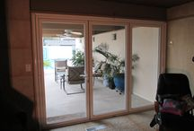 Bi-Folding Glass Doors ~ StowAway Retractable Screens / Check out the latest trend in modern home design with these bi-folding glass doors that swing out. StowAway Retractable Screen Doors are the perfect fit for these doors!