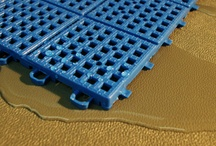 Wet Area Floor Tiles / Perforated floor tiles for pool surrounds, showers and locker room areas, and any wet area indoors and outdoors.